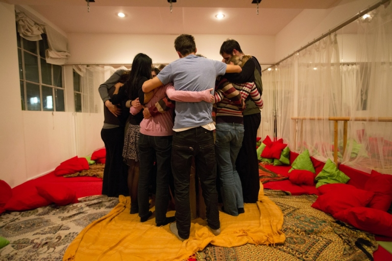 <p>People embrace during a 'Cuddle Workshop' in London on Nov. 4, 2012.</p>