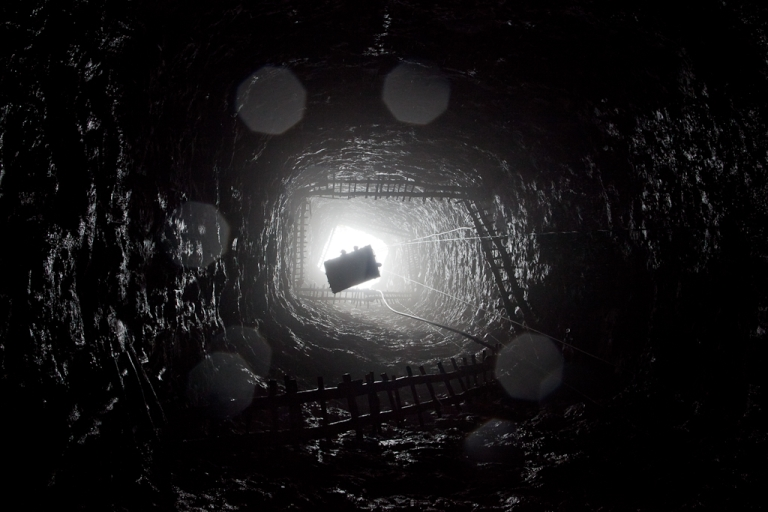 <p>A crane lifts miners out of a 300ft deep mine shaft, as they head out for their lunch break on April 13, 2011 near the village of Latyrke near Lad Rymbai, in the district of Jaintia Hills, India.</p>