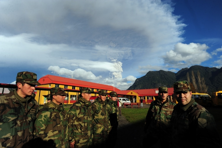 <p>Chilean soldiers stand at attention in the village of Rininahue on June 5, 2011.</p>