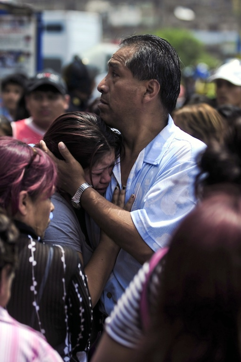 <p>Relatives of patients of the Christ is Love rehabilitation center for drug and alcohol addicts in Lima comfort each other after a deadly blaze on January 28, 2012.</p>