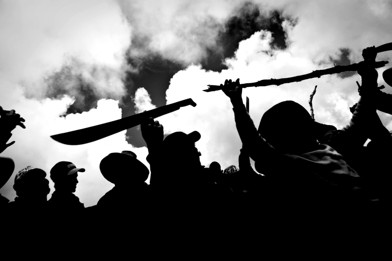 <p>Andean people brandish machetes and sticks during a protest against plans for a huge open-pit Conga goldmine on Nov. 24, 2011 in Cajamarca, in the high Andes of Peru. The US-based mining company Newmont has promised modern reservoirs to replace threatened mountain lakes but there are also fears that pollution from the mine could affect agriculture and livestock.</p>