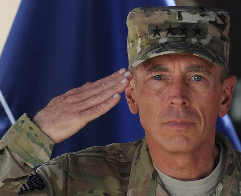 <p>Commander of NATO troops in Afghanistan, U.S. General David Petraeus, salutes during a change of command ceremony at ISAF headquarters in Kabul.</p>