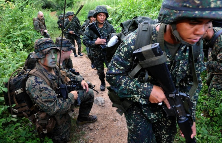 <p>U.S. Marines provide training and intelligence to their Philippine counterparts in this file photo. Seven Philippine troops were killed in a battle with Islamic militants on Thursday.</p>