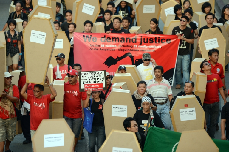 <p>Philippine journalists and students carry mock coffins as they march towards Malacanang Palace in Manila on Nov. 23, 2012, to commemorate the third anniversary of the Maguindanao massacre.</p>