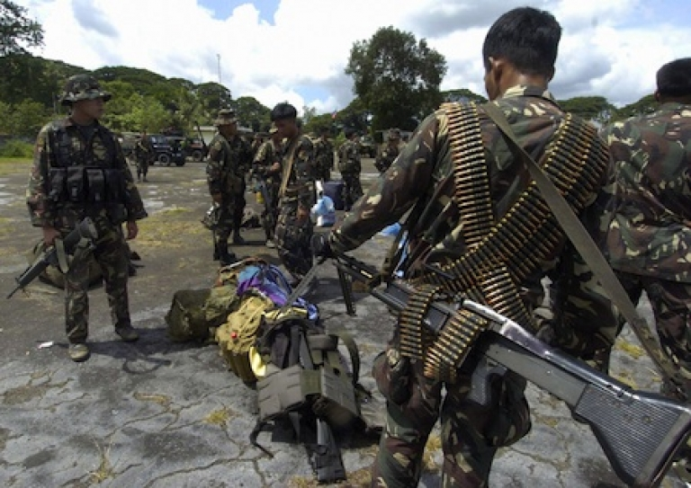 <p>Elite U.S.-trained Philippine army scout rangers arrive fully armed with heavy weapons to support the 5,000 soldiers combating Muslim insurgents in the island nation's south.</p>