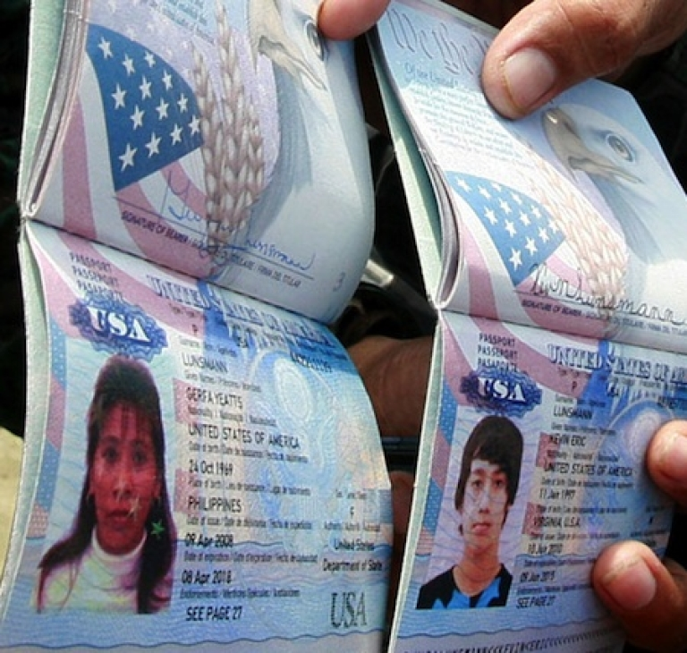 <p>Police in the Philippines display two U.S. passports of Gerfa Yeatts Lunsmann and her son, Kevin, on July 12, 2011. Gunmen abducted two the U.S. citizens and their Filipino relative holidaying at a tiny southern Philippine island, police said. Gerfa Yeatts Lunsmann, 50, her son, Kevin, 14, and her Filipino nephew, Romnick Jakaria, 19, were snatched by more than a dozen gunmen who raided the island by boat before dawn.</p>