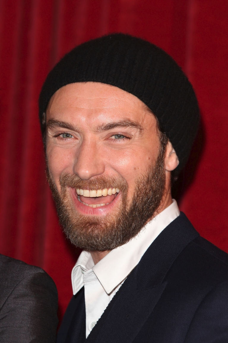 <p>Phone-hacking victim Jude Law smiling at a London premiere last month.  He is probably smiling again today after receiving damages in excess of $200,000 for having his phone-hacked from Rupert Murdoch's News International</p>