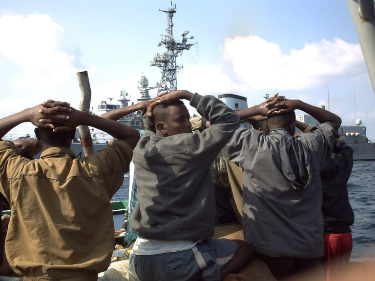 <p>Several of the 19 captured Somali pirates, seen in this Jan. 4, 2009 photo released by the French Navy, with their hands on their heads, are taken to the French naval vessel