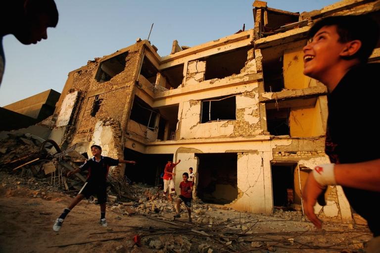 <p>Iraqi boys kicking around soccer ball in Baghdad.</p>