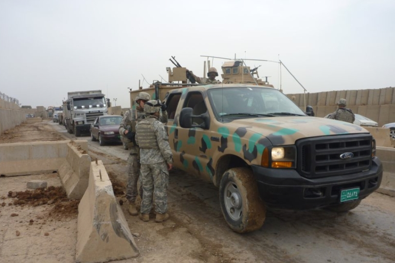 <p>Iraqi soldiers pass through one of the combined security checkpoints near Mosul.</p>