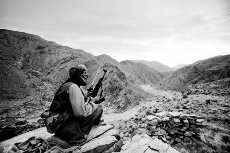 <p>A Baluchistan Liberation Army (BLA) guerrilla fighter stands guard near a BLA camp in the scrubland of Bolan, a two-hour drive from Quetta, capital of the Pakistan province of Baluchistan.</p>