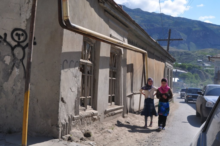 <p>Two girls walk in a mountain village on the road from Makhachkala to Balakhani in Dagestan in May 2010.</p>