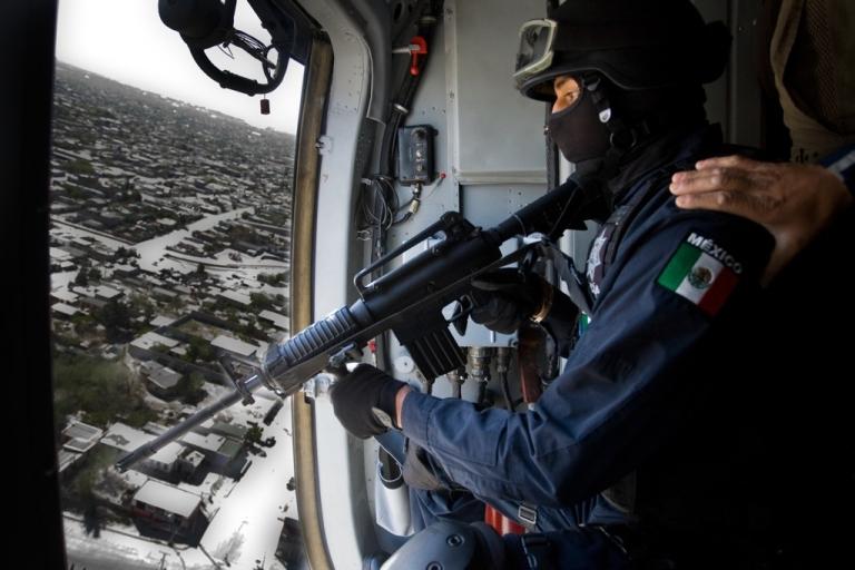 <p>A police helicopter flies over Ciudad Juarez on patrol, April 8, 2010. (Jesus Alcazar/AFP/Getty Images)</p>