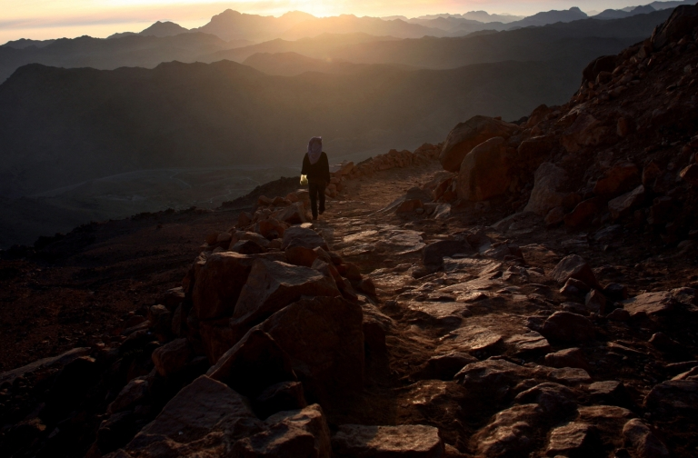 <p>A Bedouin walks on Mount Moses in the Sinai Peninsula.</p>