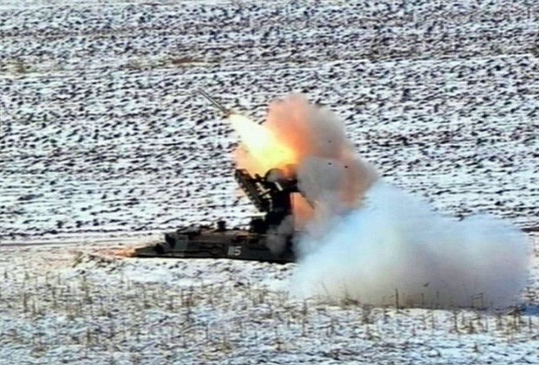 <p>This video grab taken from North Korean TV on March 20, 2013 shows a Self-Propelled Suface to Air Missile during North Korean leader Kim Jong-Un's overseeing of a live fire military drill using drones and cruise missile interceptors.</p>