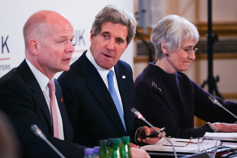 <p>British Foreign Secretary William Hague (L) sits next to US Secretary of State John Kerry (C) during the opening session of the G8 Foreign Ministers meeting at Lancaster House in London on April 11, 2013.</p>
