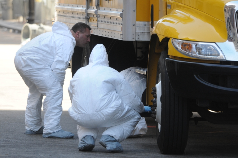 <p>FBI crime scene investigators search a truck left on Boylston Street just past Berkeley Street April 17, 2013 in Boston, Massachusetts. Investigators continue to work the scene of two bomb explosions at the finish line of the marathon that killed 3 people and injured over one hundred more.</p>