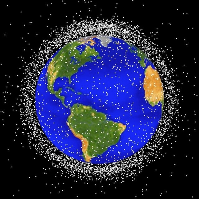<p>This National Aeronautics and Space Administration (NASA) handout image shows a graphical representation of space debris in low Earth orbit.</p>