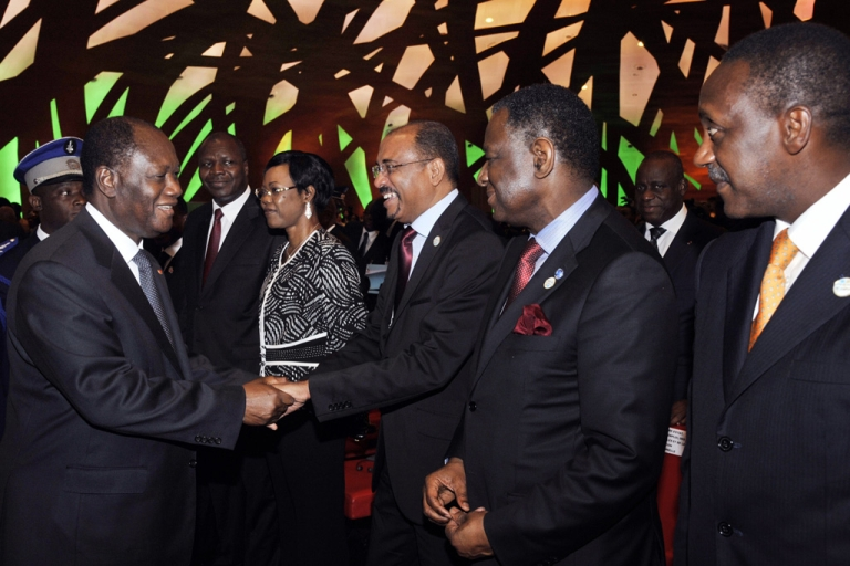 <p>Ivory Coast's President Alassane Ouattara (L) greets participants on March 25, 2013 during the meeting of the finance and economy ministers and the African Union Development Planning in Abidjan. The theme of the sixth AU-ECA joint annual meetings was