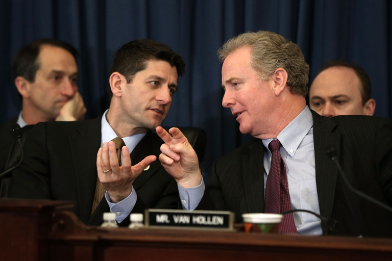 <p>Committee chairman U.S. Rep. Paul Ryan (R-WI) (L) speaks as ranking member Rep. Chris Van Hollen (D-MD) (R) listens during a hearing before the House Budget Committee April 16, 2013 on Capitol Hill in Washington, DC.</p>