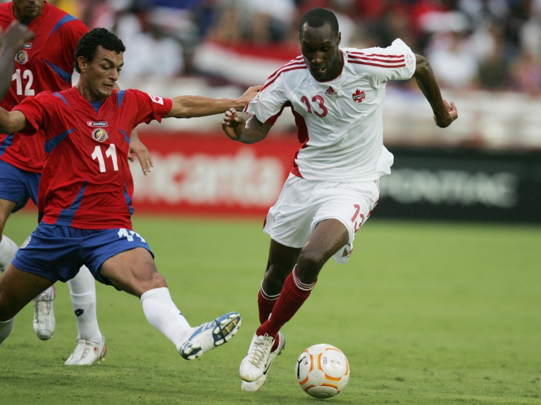 <p>Atiba Hutchinson of Canada (R) dribbles past Michael Barrentos of Costa Rica (L) in their CONCACAF Gold Cup 2007 first round match at the Orange Bowl Stadium in Miami, Florida 06 June 2007.</p>