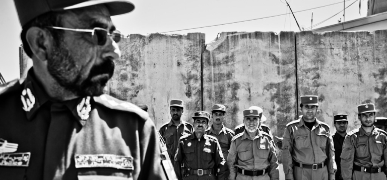 <p>Col. Jalani Khan, the deputy police chief of Zabul, stands at the head of a formation of top Zabul security officials in Qalat.</p>