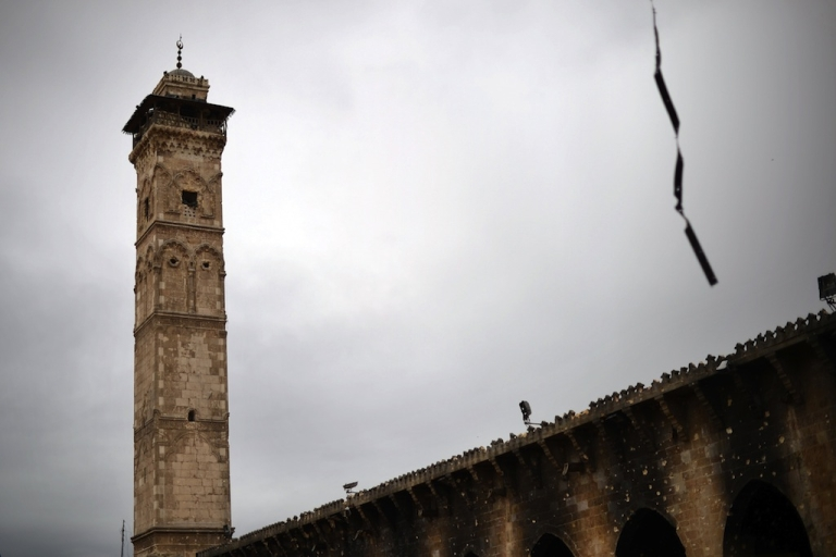 <p>A picture taken on April 16, 2013 shows the minaret of the Umayyad Mosque complex in the old part of Syria's northern city of Aleppo. After nine months of fighting that has devastated many districts in Aleppo, rebels now control more than half of the city.</p>