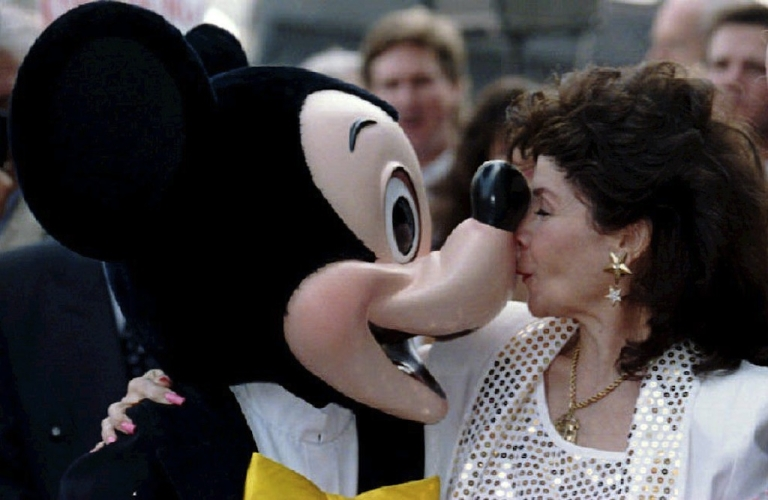 <p>Annette Funicello (R) kisses Mickey Mouse on September 14, 1993 after she received a star on the famous Hollywood Walk of Fame in California.</p>