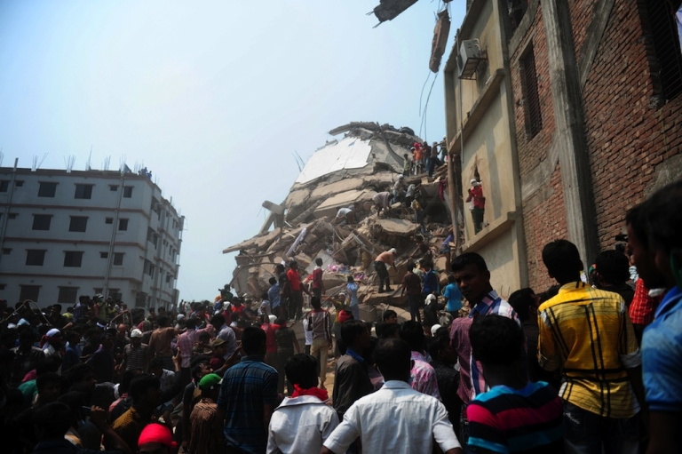 <p>Bangladeshi volunteers and rescue workers assist in rescue operations 48 hours after an eight-story building collapsed in Savar, on the outskirts of Dhaka, on April 26, 2013.</p>