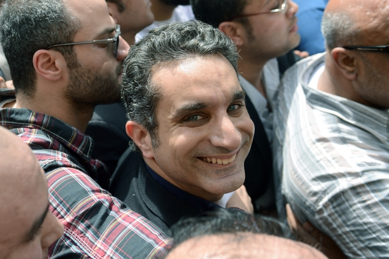 <p>Egyptian satirist and television host Bassem Youssef is surrounded by his supporters upon his arrival at the public prosecutor's office in the high court in Cairo, on March 31, 2013.</p>