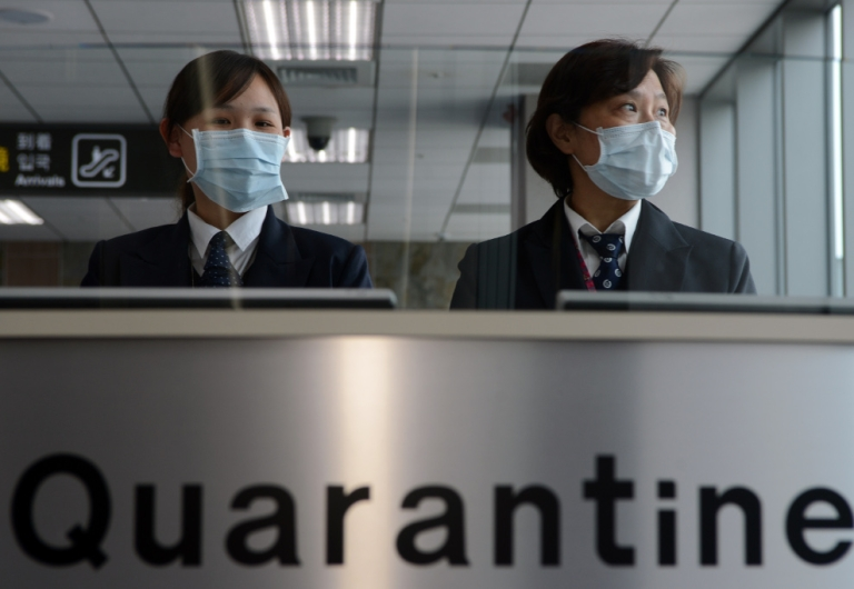 <p>Taiwan's Center for Disease Control staff stand at the entrance of Sungshan Airport in Taipei on April 4, 2013. Taiwan enhanced its level of alert against bird flu and set up a contingency center after China's report of a new strain of avian influenza.</p>