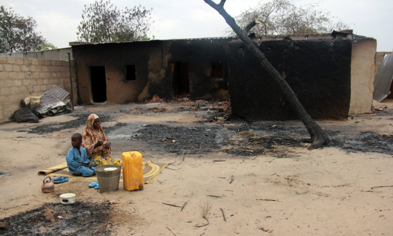 <p>Children sit in front of a burnt house in the remote northeast town of Baga on April 21, 2013 after two days of clashes between officers of the Joint Task Force and members of the Islamist sect Boko Haram on April 19 in the town near Lake Chad, 200 kms north of Maiduguri, in Borno State. Nigerian rescue workers set up temporary camps in Baga on April 25 and distributed aid to the masses displaced by brutal fighting that left 187 people dead. The bloodshed in Baga likely marked the deadliest-ever episode in the insurgency of Boko Haram, a radical group which has said it wants to create an Islamic state in northern Nigeria.</p>