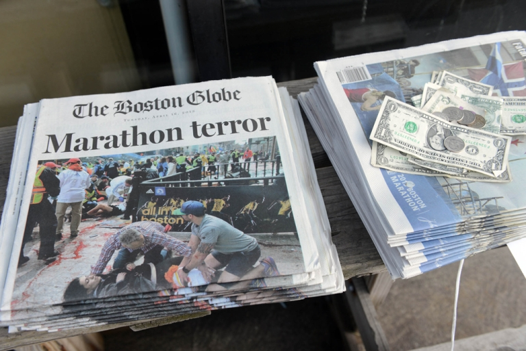 <p>Newspapers on sale at a stand on Newbury Street on April 16, 2013 in Boston.</p>