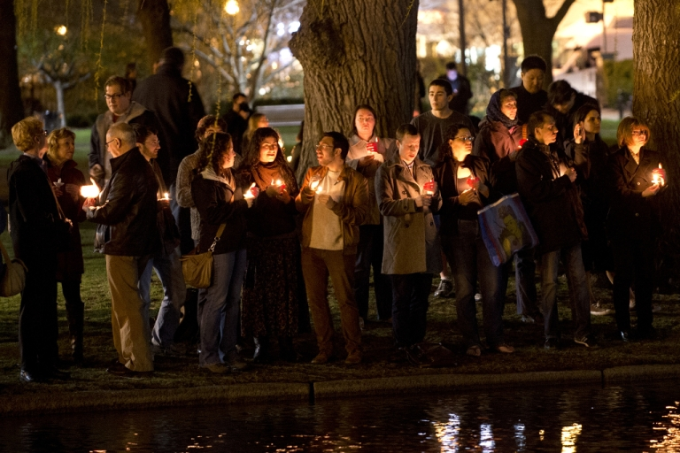 <p>Mourners gather on the edge of the pond in the Boston Public Gardens for a candlelight vigil April 16, 2013 in Boston. A few hundred people gathered to remember the victims of the bombs which exploded during the running of the Boston Marathon.</p>