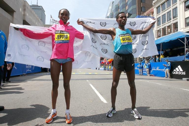 <p>Rita Jeptoo of of Kenya (L) winner of the women's division and Lelisa Desisa Benti of Ethiopia, winner of the men's division, pose for photos during post-race activities of the 117th Boston Marathon on April 15, 2013 in Boston, Massachusetts.</p>