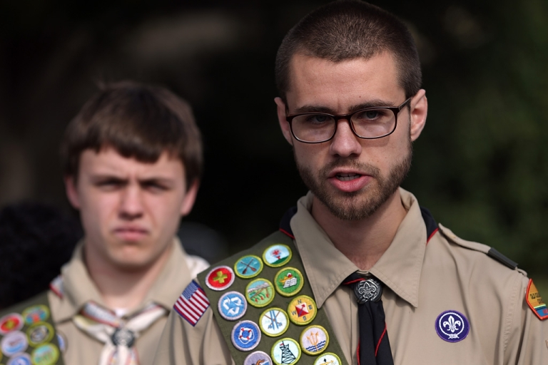 <p>Eagle Scouts Will and James Oliver talk to media after delivering boxes containing 1.4 million signatures urging the Boy Scouts of America to reverse the organization's ban on gay Scouts on February 4, 2013 in Irving, Texas.</p>