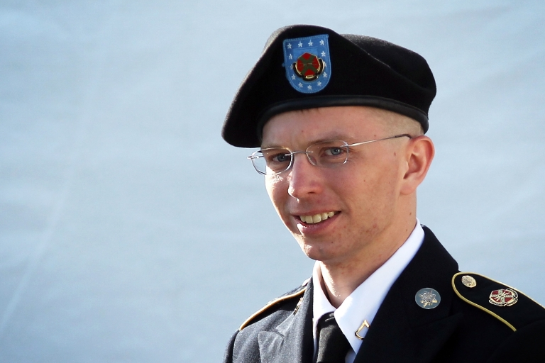 <p>US Army Private Bradley Manning leaves a military court at the end of the first of a three-day motion hearing June 6, 2012 in Fort Meade, Maryland.</p>
