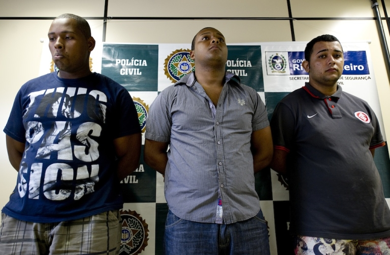 <p>(L-R) Wallace Aparecido Silva, Carlos Armando Costa dos Santos and Jonathan Froudakis de Souza, who allegedly raped a foreign tourist in a van in Rio de Janeiro on March 30, 2013 are presented to the press in Rio on April 2, 2013. The three are accused of the rape of an American student who was assaulted as her French boyfriend was forced to look on during a horrific six-hour abduction aboard a Rio public transportation van, local media reported.</p>