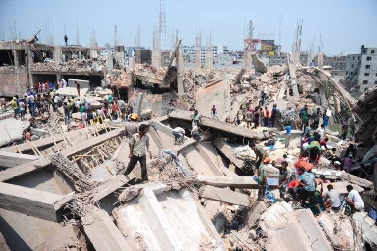 <p>Bangladeshi civilian volunteers assist in rescue operations after an eight-story building collapsed in Savar, on the outskirts of Dhaka, on April 24, 2013. Nearly 100 people were killed and many more are feared dead, officials said.</p>