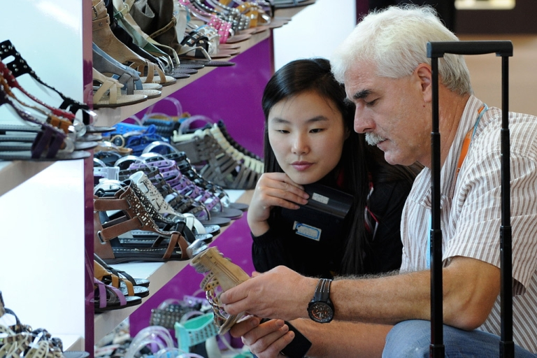 <p>Buyers check out products at the Canton Trade Fair in the southern Chinese city of Guangzhou on November 3, 2009.</p>
