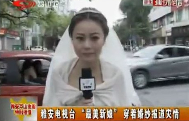 <p>Chinese news anchor Chen Ying reports on the 7.0-magnitude earthquake that hit Sichuan province in her wedding dress.</p>