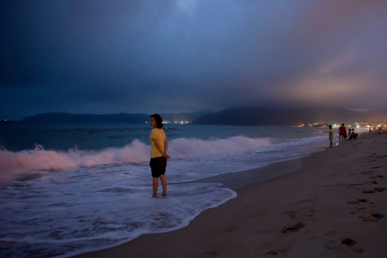 <p>A woman stands in the sea at a beach in the Yalong Bay area of Sanya, on the southern Chinese island of Hainan on Apr. 4, 2013.</p>