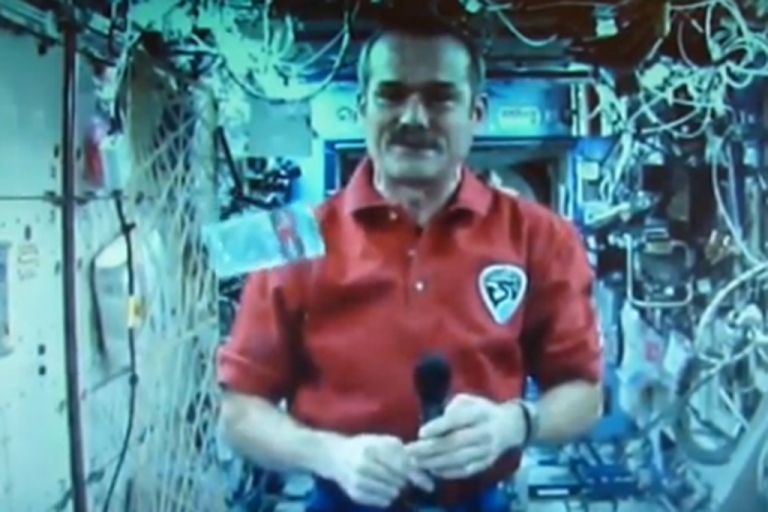 <p>Astronaut Chris Hadfield reveals the new Canadian $5 bill during a publicity event aboard the International Space Station on April 30, 2013. The $5 and $10 bills are made from polymers instead of paper.</p>