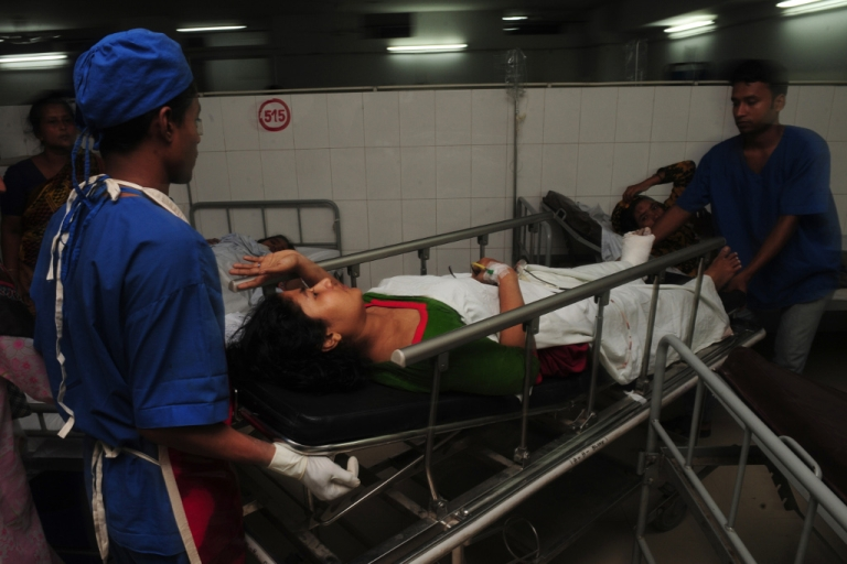 <p>A Bangladeshi victim is carried through a hospital after a building collapse in Savar, on the outskirts of Dhaka, on April 24, 2013.</p>