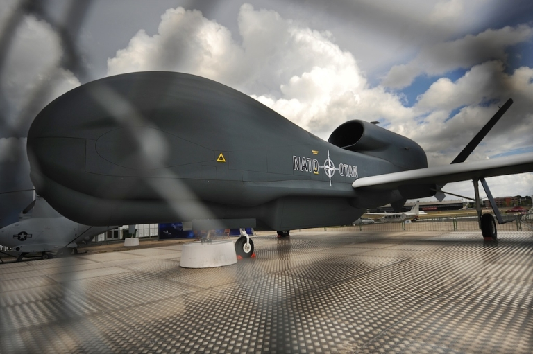 <p>A Northrop Grumman RQ-4 Global Hawk unmanned aircraft is pictured at the Farnborough International Airshow in Hampshire, southern England, on July 22, 2010. Amid the rush to buy commercial planes at the Farnborough airshow this week, aerospace companies showed off the latest drones set to play a growing role in combat.</p>