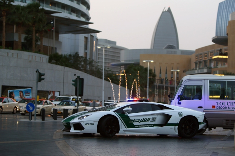 <p>Emirati policemen patrol in a Lamborghini Aventador near Burj Khalifa in the Gulf emriate of Dubai on April 12, 2013. A sleek $550,000 Lamborghini Aventador, which can reach speeds of up to 217 mph, has joined the city's fleet of patrol cars to enhance the glizty Gulf emirate's trademark image of luxury and prosperity.</p>