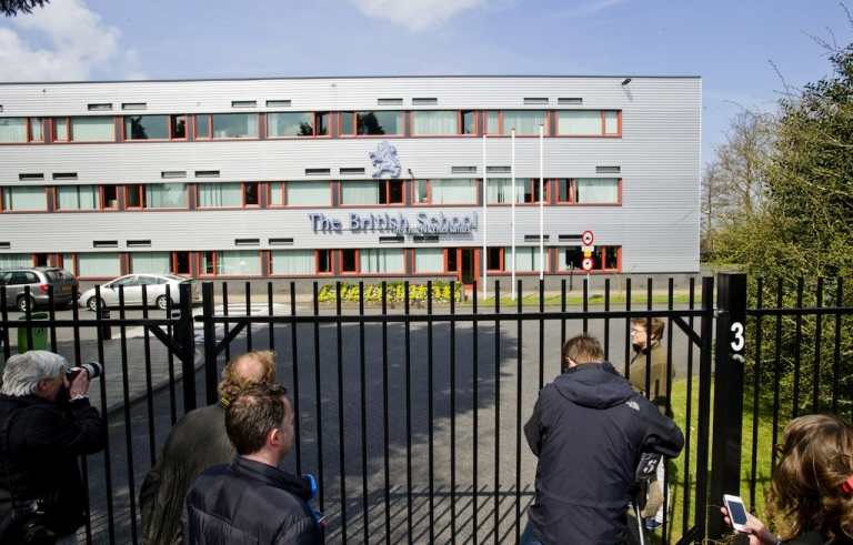 <p>The media gather in front of the British School in Voorschoten, The Netherlands, on April 22, 2013. Dutch police arrested a former pupil at a British school in the Netherlands on Monday in connection with a threat to go on a shooting spree that saw armed police deployed and schools closed. Police in the university city of Leiden, just northeast of The Hague, confirmed one person had been arrested following the threat to 'shoot my Dutch teacher and as many students as I can,' made on an internet site over the weekend.</p>