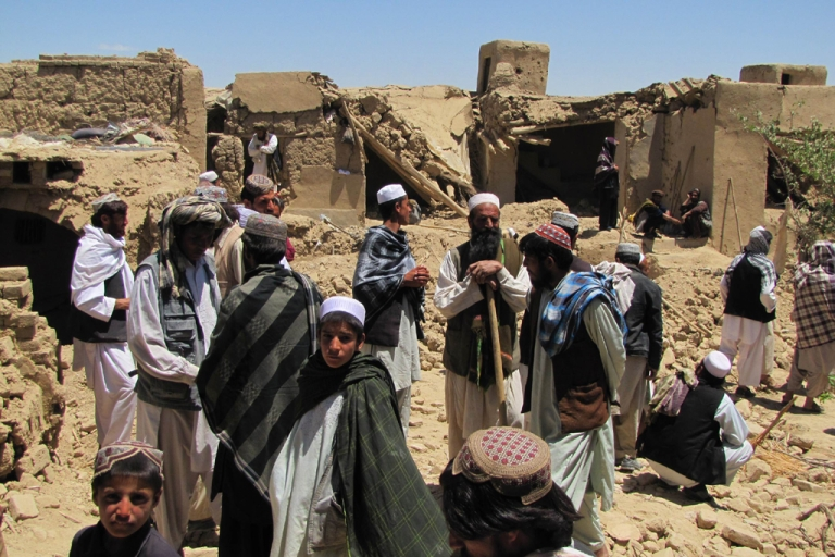 <p>An Afghan villager stands at a house which was hit by a NATO airstrike in Logar province, south of Kabul, on June 6, 2012.</p>