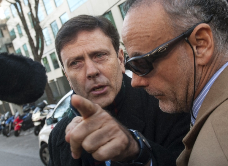 <p>Doctor Eufemiano Fuentes (L) arrives at a court house in Madrid on January 28, 2013. Fuentes has been convicted of masterminding a vast doping network that rocked the sporting world and snared top cyclists. The case centered on a sophisticated network which was blown wide open on May 23, 2006 when Spanish police seized around 200 bags of blood in an investigation dubbed 'Operation Puerto'.</p>