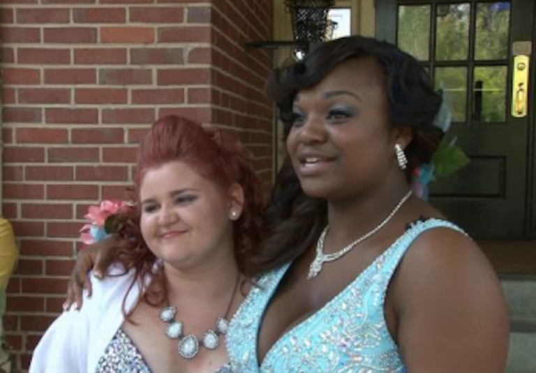 <p>Two students from Wilcox High School in Georgia attend their first racially integrated prom on April 27, 2013.</p>